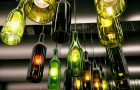 Beautiful retro light lamp decor made of the wine bottles. Toned